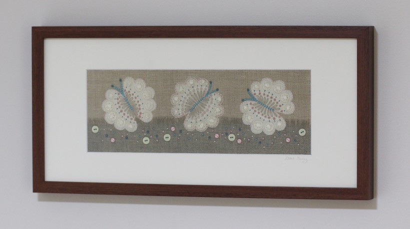 Butterflies fluttering over field embroidery-Lilibet Stanley
